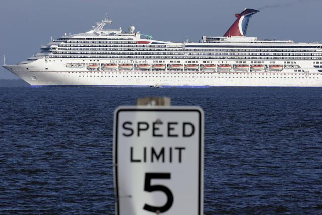 The cruise ship Carnival Triumph into Mobile Bay near Dauphin island, Ala., Thursday, Feb. 14, 2013. The ship with more than 4,200 passengers and crew members has been idled for nearly a week in the Gulf of Mexico following an engine room fire. (AP Photo/Dave Martin)