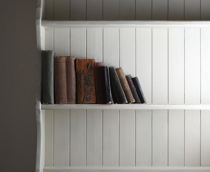 "<p>Resist the impulse to push books toward the back wall. Instead, bring them forward. </p><p>""My favorite tip is so simple,"" DeMorrow says. ""Move all the books to meet the front edge of the bookshelf, giving a uniform look and eliminating telltale dust.""</p>"