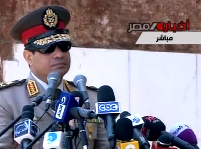 """In this image taken from Egypt State TV, Egyptian Defense Minister Gen. Abdel-Fattah el-Sissi delivers a speech in Cairo, Egypt, Wednesday, July 24, 2013. El-Sissi has called on Egyptians to hold mass demonstrations to voice their support for the military to put an end to """"violence"""" and """"terrorism."""" (AP Photo/Egypt State TV)"""