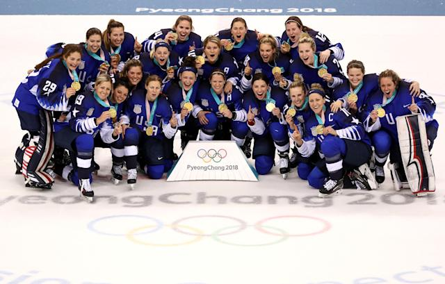 <p>Gold medal winners the United States celebrate after defeating Canada in a shootout in the Women's Gold Medal Game on day thirteen of the PyeongChang 2018 Winter Olympic Games at Gangneung Hockey Centre on February 22, 2018 in Gangneung, South Korea. (Photo by Jamie Squire/Getty Images) </p>