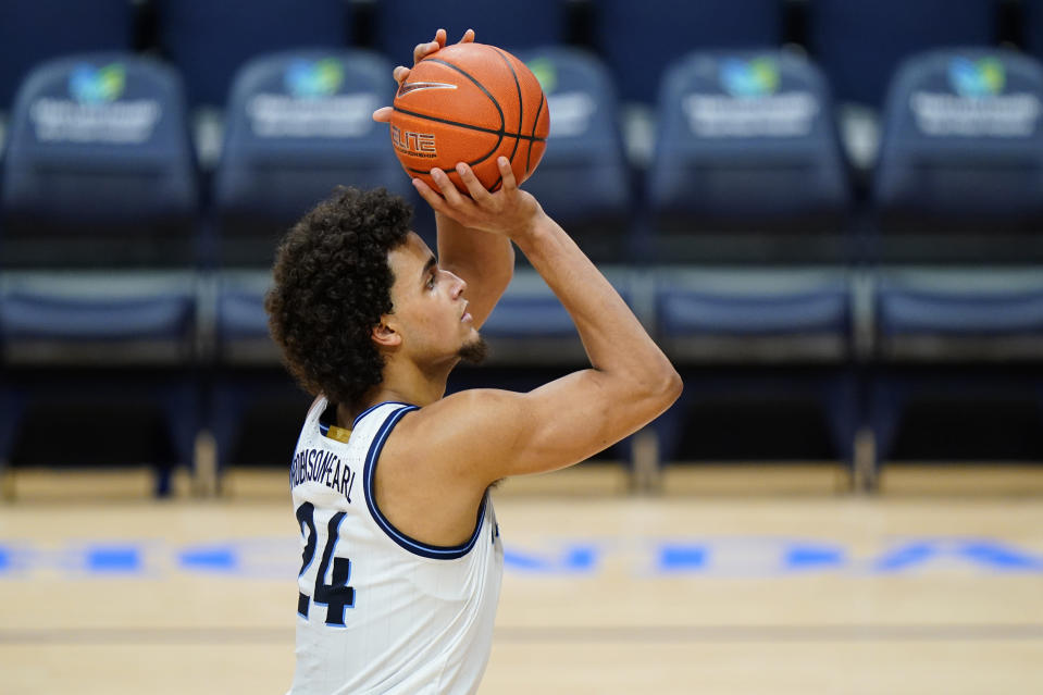 Villanova's Jeremiah Robinson-Earl takes a free-throw during the first half of an NCAA college basketball game against Marquette, Wednesday, Feb. 10, 2021, in Villanova, Pa. (AP Photo/Matt Slocum)