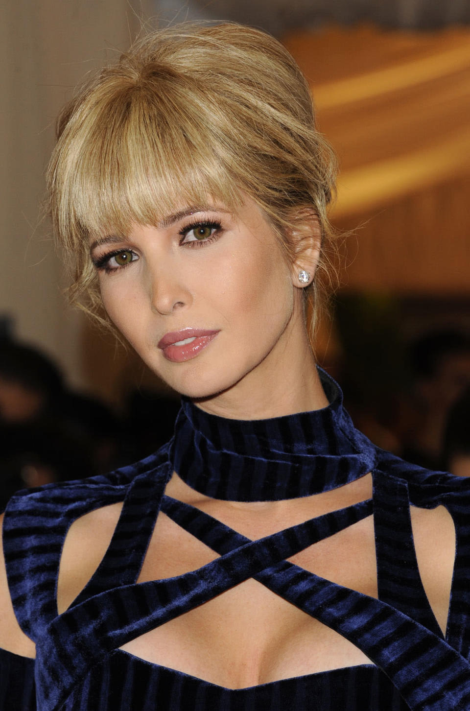 <p>Full bangs accentuate Ivanka's updo and copper eyeliner. (Photo: AP Images) </p>
