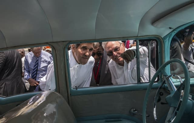 FILE – In this Aug. 14, 2015 file photo, Havana city historian Eusebio Leal Spengler, right, points out something to then US secretary of state John Kerry as they peer into the interior of a classic American car parked in Old Havana, Cuba (Ramon Espinosa/AP)