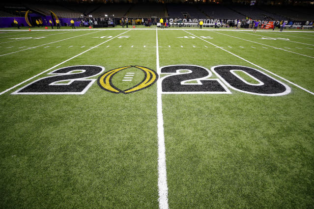 The CFB 2020 Logo is displayed on the field prior to the College Football Playoff title game between LSU and Clemson on Jan. 13. (Todd Kirkland/Icon Sportswire via Getty Images)