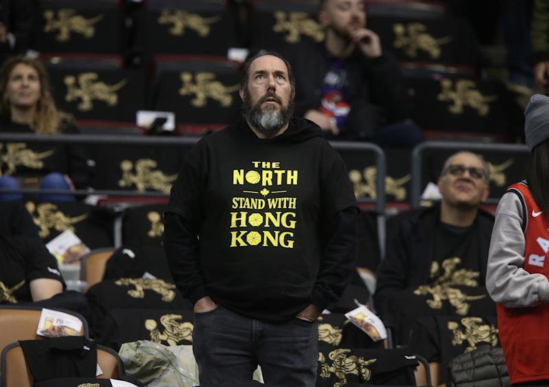 "A fan wore a ""Stand With Hong Kong"" T-shirt when the Raptors opened their 2019-20 season. (Steve Russell/Toronto Star via Getty Images)"