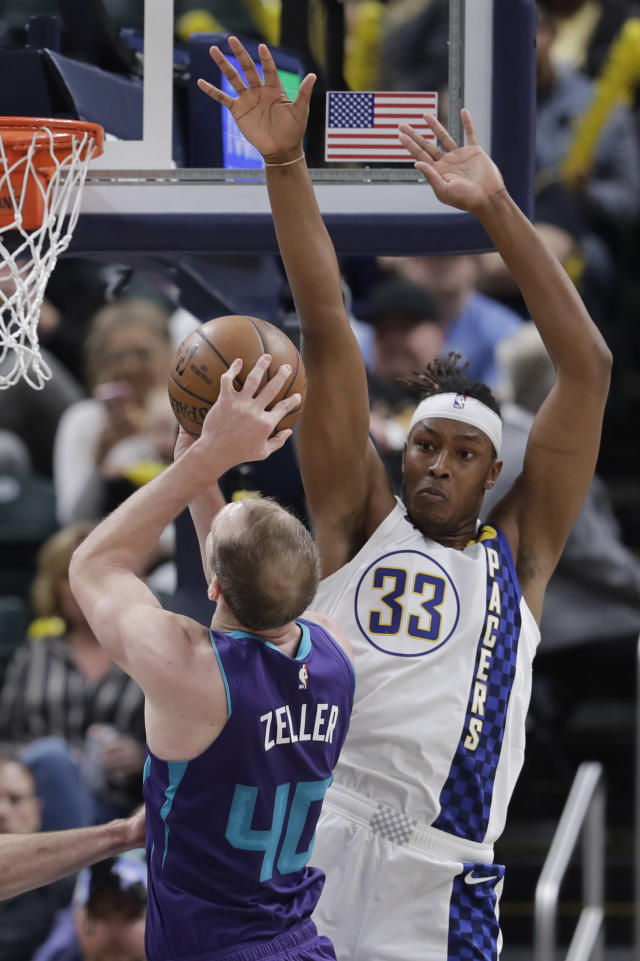 Charlotte Hornets' Cody Zeller (40) shoots against Indiana Pacers' Myles Turner (33) during the second half of an NBA basketball game, Sunday, Dec. 15, 2019, in Indianapolis. (AP Photo/Darron Cummings)