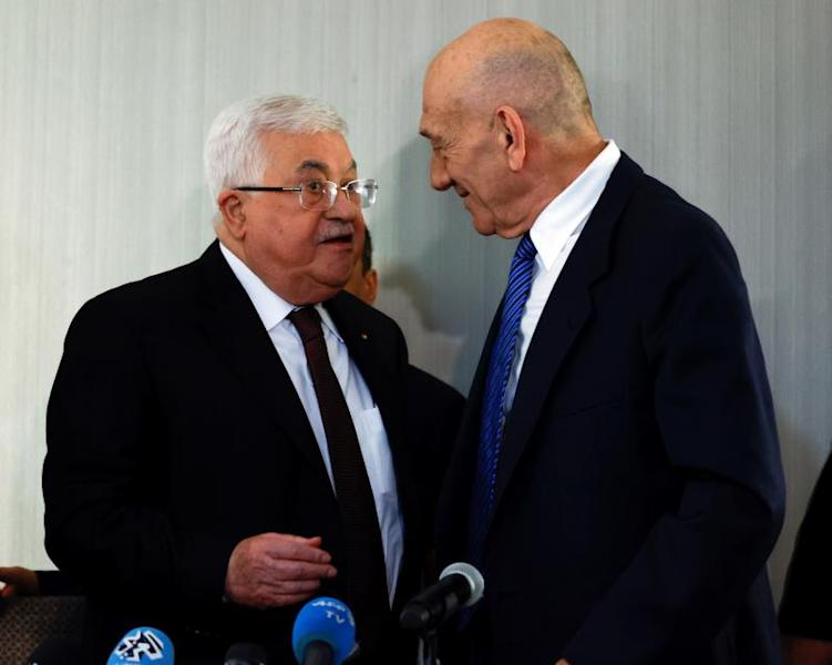 Former Israeli Prime Minister Ehud Olmert (R) and Palestinian President Mahmoud Abbas (L) talk after a joint press conference at the Grand Hyatt Hotel in New York, New York, USA, 11 February 2020. EFE/EPA/JASON SZENES