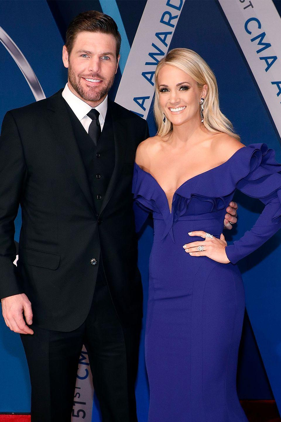 """<p>The GRAMMY-winning country singer met her NHL player husband after they were set up on a blind date by friends...despite the fact they lived in different countries at the time.</p><p>""""I mean, can I make dating more difficult?"""" Underwood said on<a href=""""http://ew.com/article/2012/09/28/carrie-underwood-mike-fisher-behind-the-music/?"""" rel=""""nofollow noopener"""" target=""""_blank"""" data-ylk=""""slk:VH1's"""" class=""""link rapid-noclick-resp""""> VH1's</a> <a href=""""https://www.countryliving.com/life/entertainment/a41996/carrie-underwood-mike-fisher-love-story/"""" rel=""""nofollow noopener"""" target=""""_blank"""" data-ylk=""""slk:Behind the Music"""" class=""""link rapid-noclick-resp""""><em>Behind the Music</em></a>. """"Let's get a hockey guy who lives in another country. Awesome.""""</p><p>It worked out, and the couple married in 2010 and have two children together.<br></p>"""