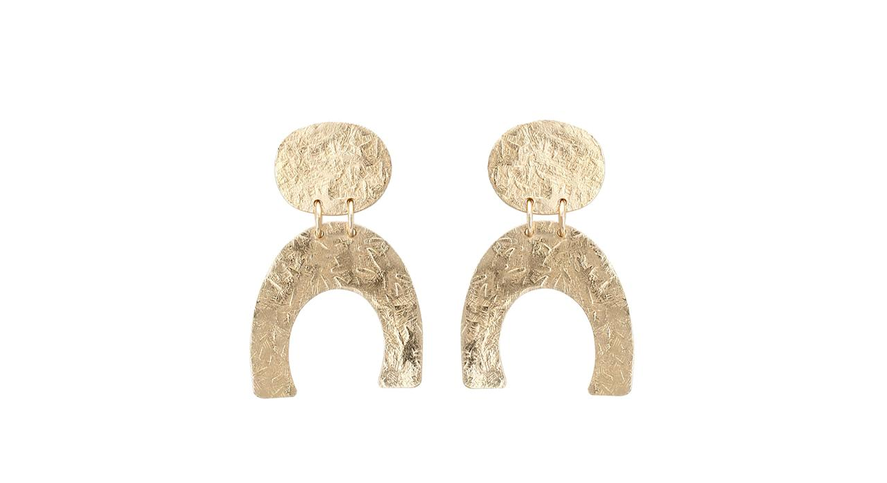"""<p>Look no further than Oliver Bonas for this season's greatest minimal pieces. Just imagine these horshoe-inspired numbers teamed with a crisp white shirt… <em><a rel=""""nofollow"""" href=""""https://www.oliverbonas.com/jewellery/faraha-statement-connected-earrings"""">Oliver Bonas</a>, £55</em> </p>"""
