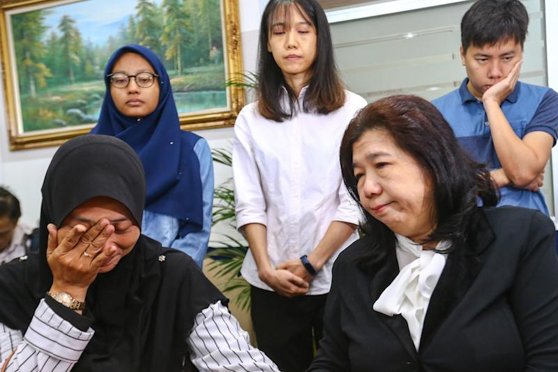 Norhayati Mohd Arifin and Susanna Koh attend the announcement of Suhakam's public inquiry findings into the disappearances of pastor Raymond Koh and Amri Che Mat in Kuala Lumpur April 3, 2019. — Picture by Hari Anggara