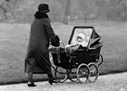 <p>Princess Elizabeth is pushed in her buggy (PA Archive) </p>