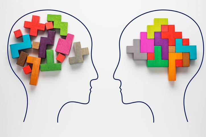 Two drawings of brains represented by colorful blocks, with one jumbled and the other orderly.