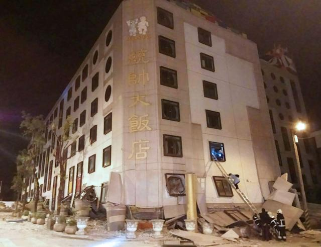 <p>Rescue workers search through rubble outside the Marshal Hotel in Hualien, eastern Taiwan early Feb. 7, 2018, after a strong earthquake struck the island.<br> (Photo: AFP/Getty Images) </p>