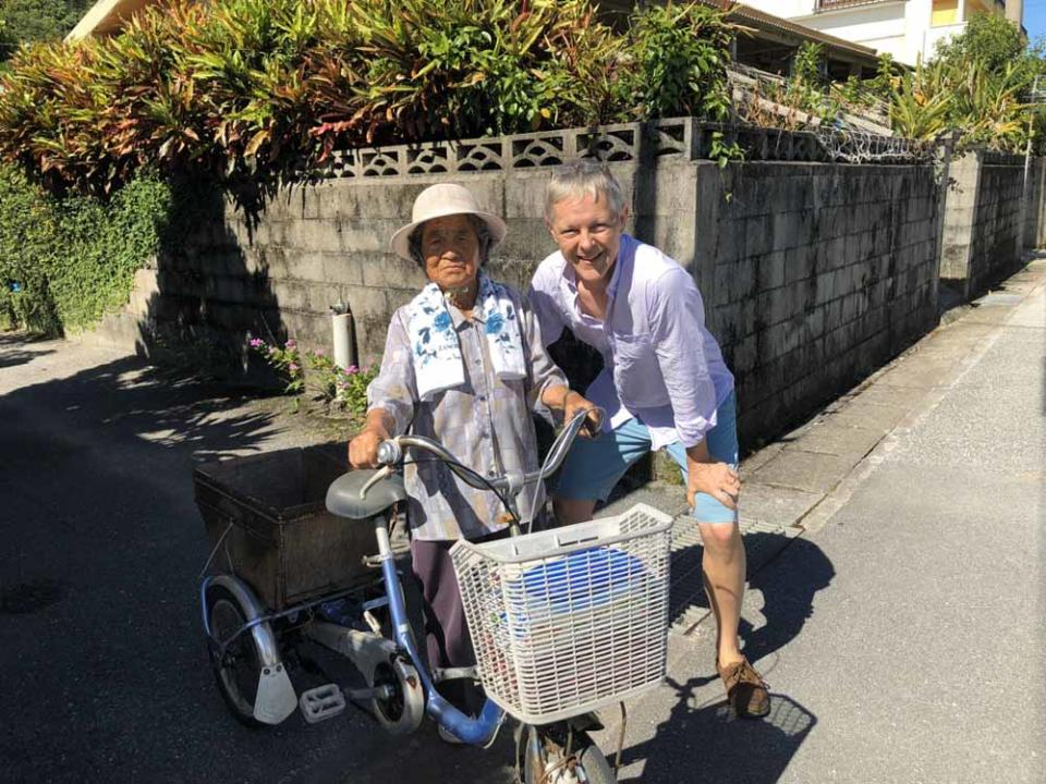 Chris in Okinawa with a 100-year-old woman. PA REAL LIFE