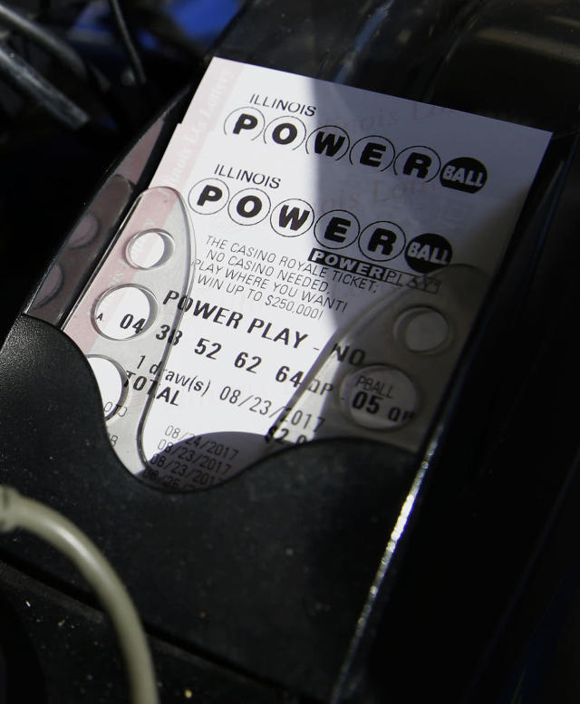 <p>A Powerball lottery ticket is printed out of a lottery machine at a convenience store, Aug. 23, 2017, in Northbrook, Ill. Lottery officials said the grand prize for Wednesday night's drawing has reached $700 million. The second -largest on record for any U.S. lottery game. (Photo: Nam Y. Huh/AP) </p>