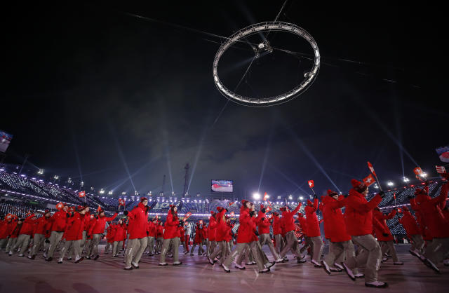 <p>Members of Switzerland team walk on the arena during the opening ceremony of the 2018 Winter Olympics in Pyeongchang, South Korea, Friday, Feb. 9, 2018. (AP Photo/Jae C. Hong) </p>