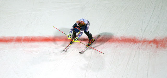 Gold medal winner Mikaela Shiffrin crosses the finish line in the women's slalom at the Sochi 2014 Winter Olympics, Friday, Feb. 21, 2014, in Krasnaya Polyana, Russia. (AP Photo/Charlie Riedel)