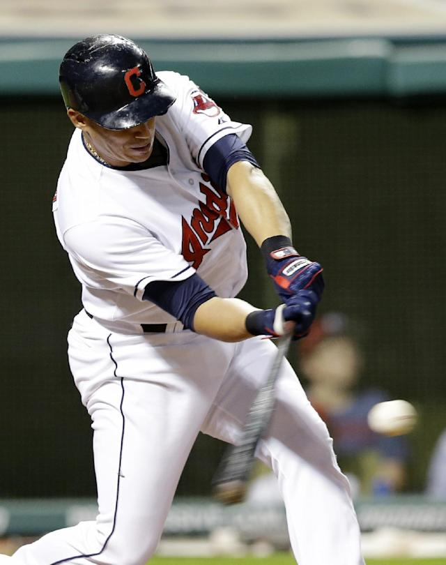 Cleveland Indians' Asdrubal Cabrera hits a three-run home run off Detroit Tigers relief pitcher Ian Krol in the eighth inning of a baseball game on Friday, June 20, 2014, in Cleveland. Indians' Mike Aviles and Michael Bourn also scored on the hit. (AP Photo/Tony Dejak)
