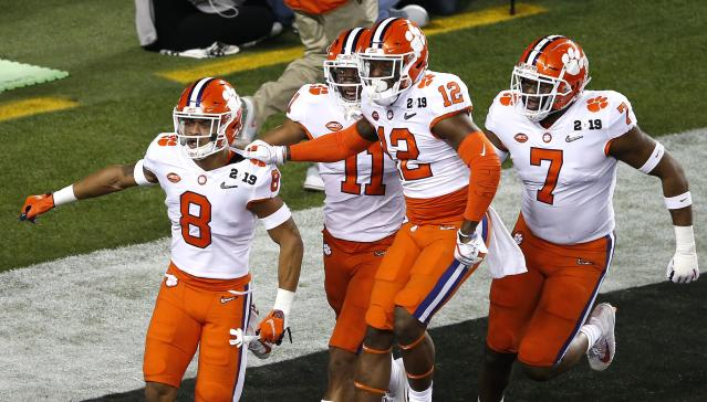 Clemson's A.J. Terrell (8) celebrates with teammates after returning an interception for a touchdown in the first quarter. (Getty)