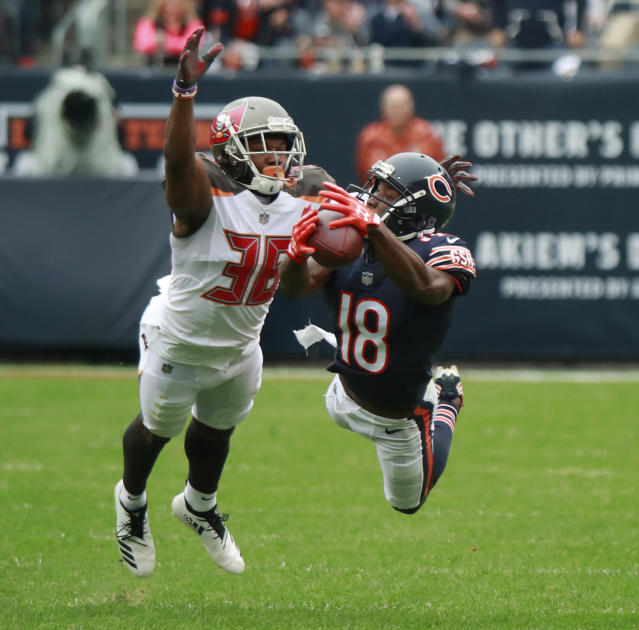 <p>Chicago Bears wide receiver Taylor Gabriel (18) makes a catch in front of Tampa Bay Buccaneers cornerback M.J. Stewart (36) during the first half on Sunday, Sept. 30, 2018, at Soldier Field in Chicago, Ill. (Nuccio DiNuzzo/Chicago Tribune/TNS via Getty Images) </p>