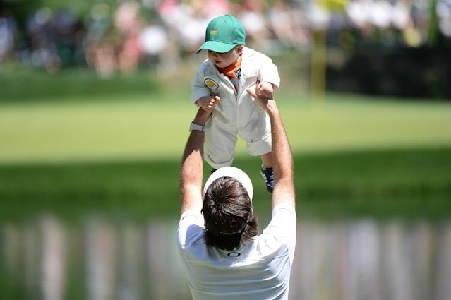AUGUSTA, GA - APRIL 10: Bubba Watson of the United States lifts his son, Caleb, during the Par 3 Contest prior to the start of the 2013 Masters Tournament at Augusta National Golf Club on April 10, 2013 in Augusta, Georgia. (Photo by Harry How/Getty Images)