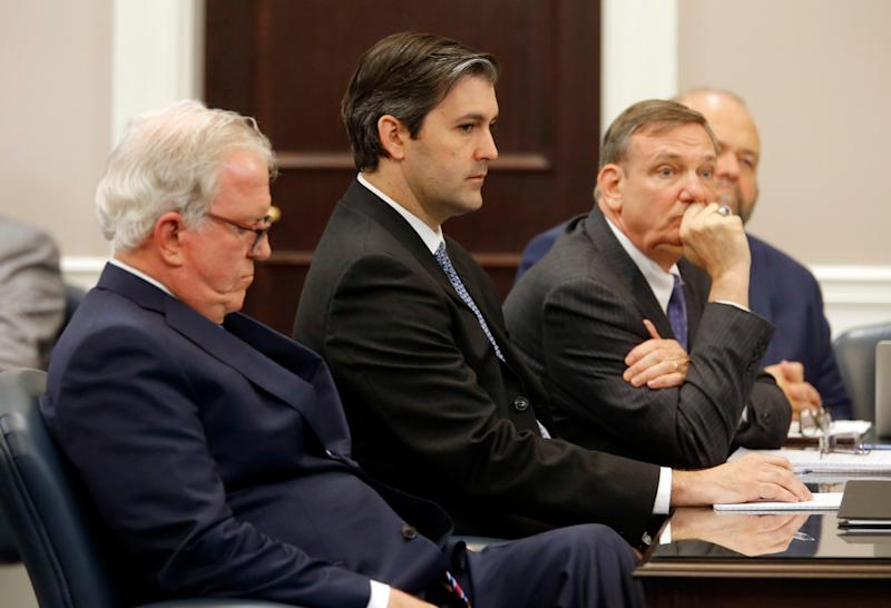 Don McCune, and Miller Shealy, right, sit around former North Charleston police officer Michael Slager at the Charleston County court - Credit: Grace Beahm/AP