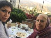 Mania Darbani and her mother Maryam Taghdissi Jani are seen in a restaurant in Tehran, Iran