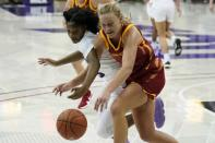 TCU guard Tavy Diggs, left, and Iowa State guard Madison Wise, right, chase after a loose ball in the second half of an NCAA college basketball game in Fort Worth, Texas, Wednesday, Dec. 2, 2020. (AP Photo/Tony Gutierrez)