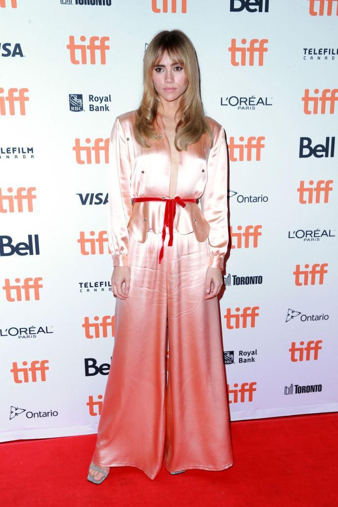 <p>On September 11, Suki Waterhouse graced the red carpet in a powder-pink silk jumpsuit at the Toronto Film Festival. <em>[Photo: Getty]</em> </p>