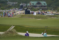 Scottie Scheffler, right, hits out of a fairway bunker on the 16th fairway as Ryan Palmer looks on during a practice round at the PGA Championship golf tournament on the Ocean Course Wednesday, May 19, 2021, in Kiawah Island, S.C. (AP Photo/Chris Carlson)