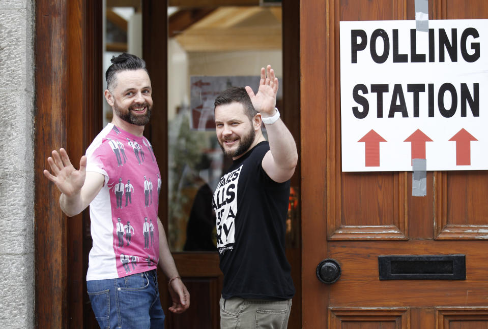 Partners Adrian, left and Shane, arrive to vote at a polling station in Drogheda, Ireland, Friday, May 22, 2015. Same-sex marriage is now legal in 28 countries worldwide, including most of Western Europe, as well as the self-governing island of Taiwan. Legalization came in various ways: through court rulings, legislation and – in the case of Ireland – a resounding endorsement by voters in a 2015 national referendum. (AP Photo/Peter Morrison)