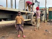 Yusuf Lado, 7 years old, who has been pulled out of school, wears sunglasses at his new fabrication and welding apprenticeship workshop at Goni Gora, Kaduna