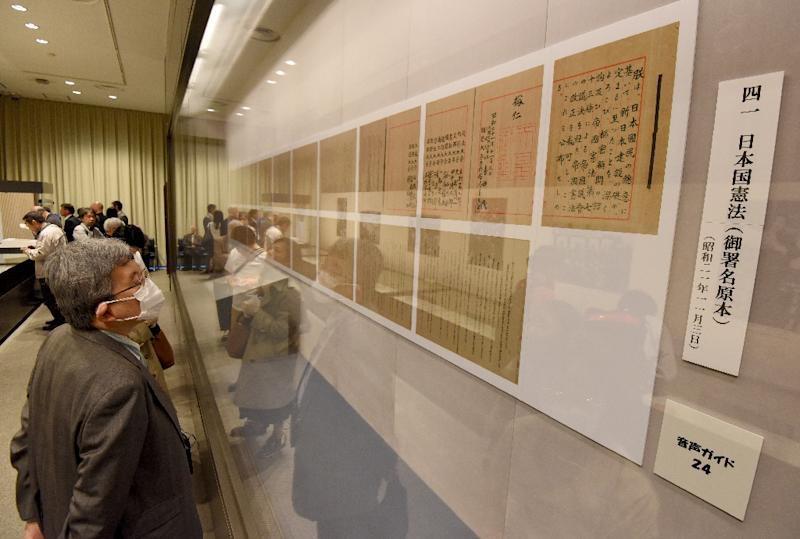 """Public opinion polling shows broad acceptance of the document, widely known as the """"peace constitution,"""" as a whole, although views are divided on the hot-button issue of Article 9 -- which renonces Japan's right to wage war (AFP Photo/Toru YAMANAKA                    )"""