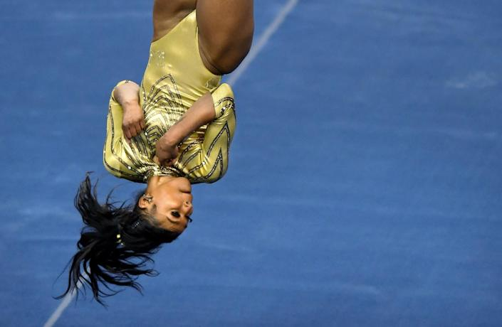 UCLA's Nia Dennis competes on the floor during competition against BYU.
