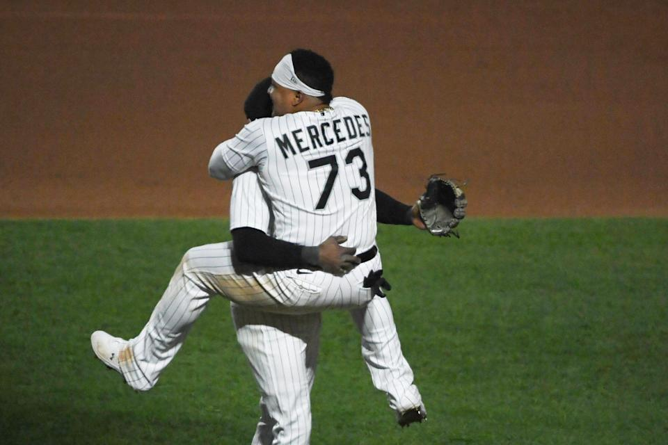 Tim Anderson and Yermin Mercedes celebrate a White Sox win.