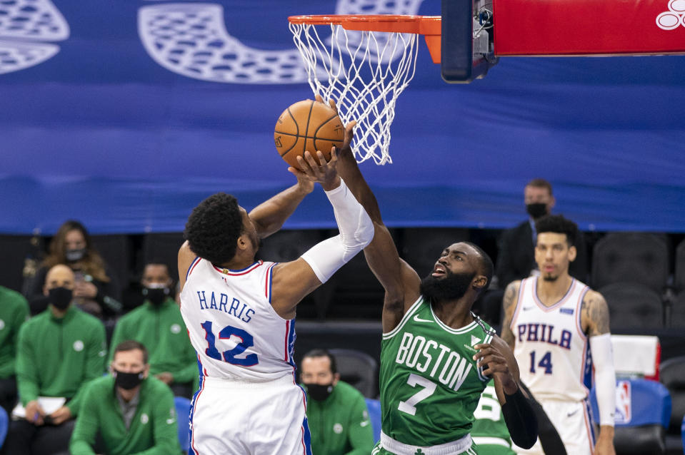 Boston Celtics guard Jaylen Brown, right, blocks a shot by Philadelphia 76ers forward Tobias Harris during the first half of an NBA basketball game Wednesday, Jan. 20, 2021, in Philadelphia. (AP Photo/Chris Szagola)