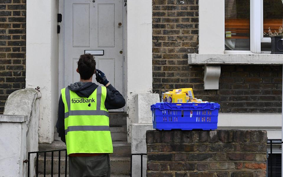 Food is delivered to a shielding household during the first wave of the Covid pandemic - Andy Rain/Shutterstock