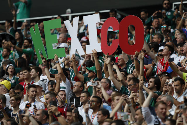 Fans hold up letters spelling out Mexico ahead of the start of the group F match between Germany and Mexico at the 2018 soccer World Cup in the Luzhniki Stadium in Moscow, Russia, Sunday, June 17, 2018. (AP Photo/Eduardo Verdugo)
