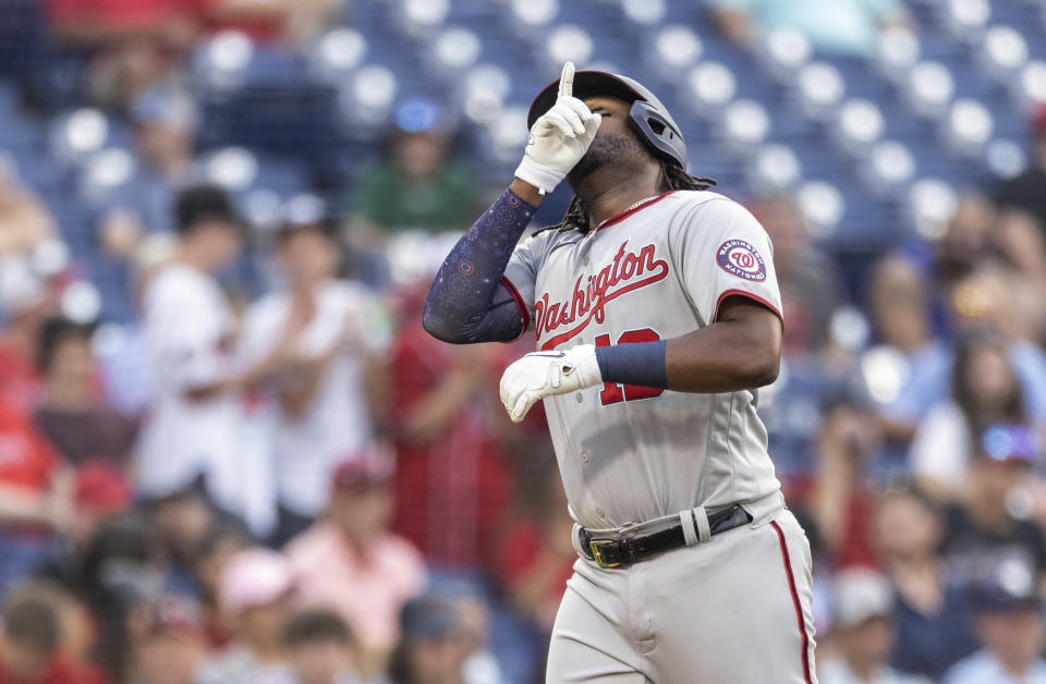 Washington Nationals' Josh Bell gestures after hitting a three-run home run during the first inning of the team's baseball game against the Philadelphia Phillies, Tuesday, July 27, 2021, in Philadelphia. (AP Photo/Laurence Kesterson)