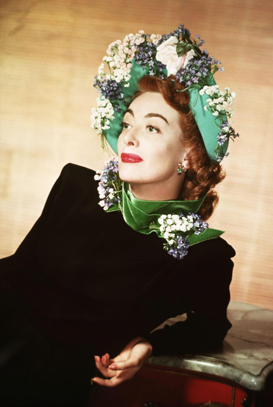 """<p>For decades, Joan Crawford held the title of Hollywood's illustrious leading lady, the jewel of cinema's golden age. But many people also remember the film star for the scandals and feuds she was involved in off-camera. Take a look back at her alluring life and career in pictures (and don't forget to browse our coverage of similarly iconic leading ladies, such as <a href=""""https://www.goodhousekeeping.com/beauty/g3608/lucille-ball-vintage-photos/"""" rel=""""nofollow noopener"""" target=""""_blank"""" data-ylk=""""slk:Lucille Ball"""" class=""""link rapid-noclick-resp"""">Lucille Ball</a> and <a href=""""https://www.goodhousekeeping.com/life/entertainment/g28307872/rare-photos-of-judy-garland/"""" rel=""""nofollow noopener"""" target=""""_blank"""" data-ylk=""""slk:Judy Garland"""" class=""""link rapid-noclick-resp"""">Judy Garland</a>). </p>"""