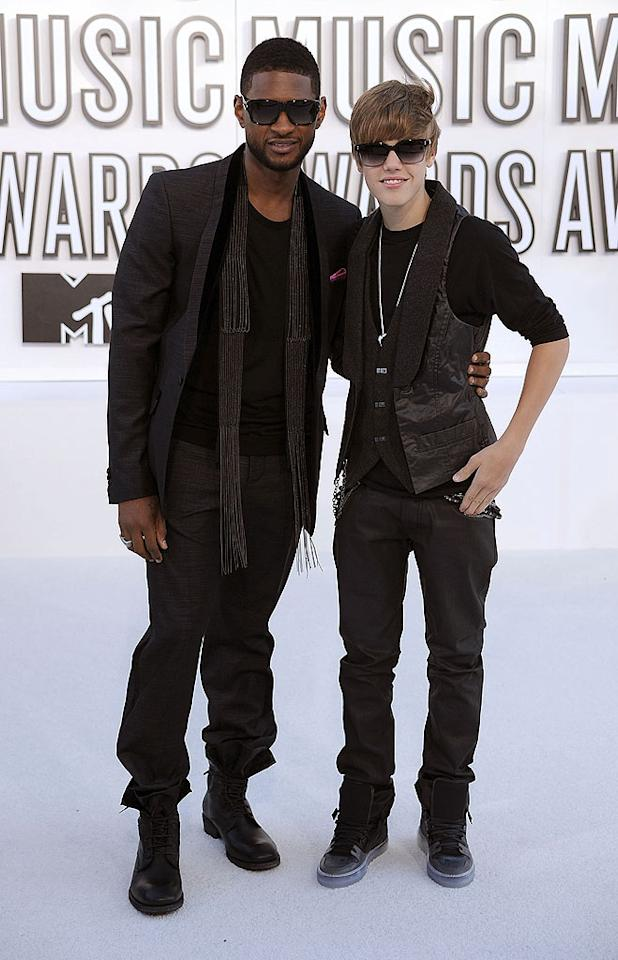 """Usher clearly inspired his protege Justin Bieber's ensemble. Not only did the duo come clad in head-to-toe black, but both fellas even tucked their pants into their shoes and donned black shades. Unfortunately, the 16-year-old pop star looked a little girly in his lady glasses while posing with the suave 31-year-old King of R&B. Steve Granitz/<a href=""""http://www.wireimage.com"""" target=""""new"""">WireImage.com</a> - September 12, 2010"""