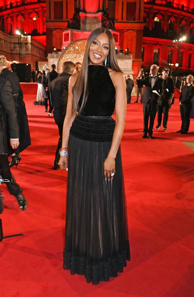 <p>OG supermodel Naomi Campbell wore a sheer black gown with supersized earrings for the ceremony. (Photo: Getty Images) </p>