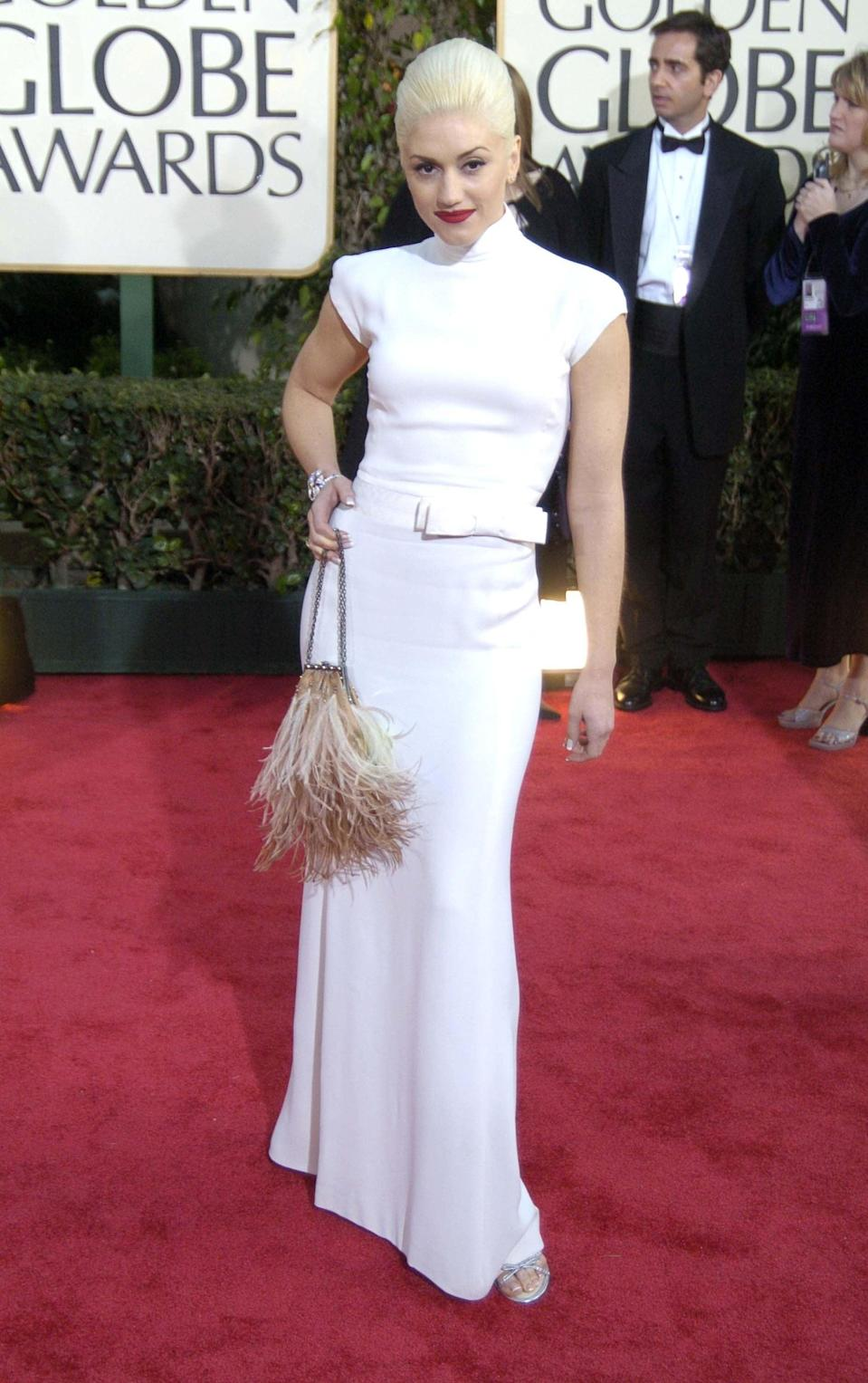 <p>She impressed everyone in this Valentino number at the 2004 Golden Globe Awards.</p>