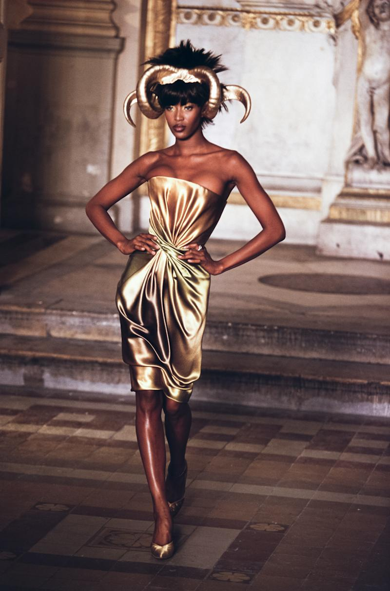 Naomi Campbell walks the runway of the Givenchy fall/winter 1997 couture show during Paris Fashion Week in 1997. Photo courtesy of Getty Images.