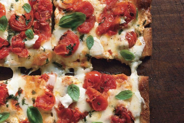"""Refrigerated dough makes this pizza easy as—ahem—pie. But it's got a lot of sophistication, too, courtesy of fresh mozz, fresh basil, and fennel seeds you'll crush yourself for the best flavor. <a href=""""https://www.epicurious.com/recipes/food/views/cherry-tomato-pizza-margherita-357889?mbid=synd_yahoo_rss"""" rel=""""nofollow noopener"""" target=""""_blank"""" data-ylk=""""slk:See recipe."""" class=""""link rapid-noclick-resp"""">See recipe.</a>"""