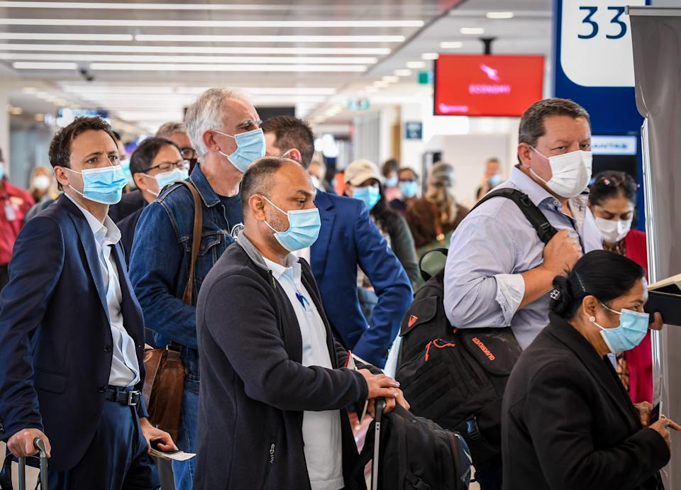 SYDNEY, AUSTRALIA - APRIL 19: Passengers wearing face masks wait to board their flight bound for New Zealand at Sydney's Kingsford Smith Airport on April 19, 2021 in Sydney, Australia. The trans-Tasman travel bubble between New Zealand and Australia begins on Monday, with people able to travel between the two countries without needing to quarantine. (Photo by James D. Morgan/Getty Images)