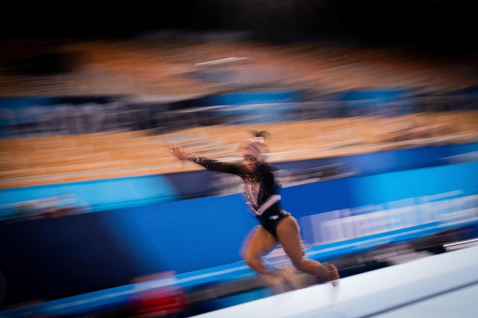 Simone Biles practices the vault during a training session at the Ariake Gymnastics Centre in Tokyo on July 22, 2021, on the eve of the start of the Tokyo 2020 Olympic Games.
