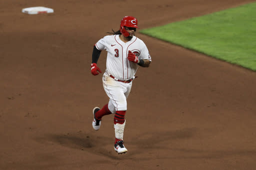 Cincinnati Reds' Freddy Galvis hits a two-run home run in the seventh inning during a baseball game against the Kansas City Royals in Cincinnati, Wednesday, Aug. 12, 2020. (AP Photo/Aaron Doster)