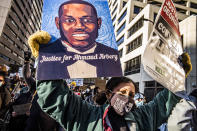 Protesters march downtown in Minneapolis, Minn., on the first day of the Derek Chauvin trial which began with jury selection, Monday, March 8, 2021. (Richard Tsong-Taatarii/Star Tribune via AP)