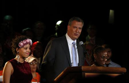 Democratic candidate for New York City mayor Bill de Blasio stands with his wife Chirlane and his daughter Chiara during his mayoral primary results party in New York September 10, 2013. REUTERS/Shannon Stapleton